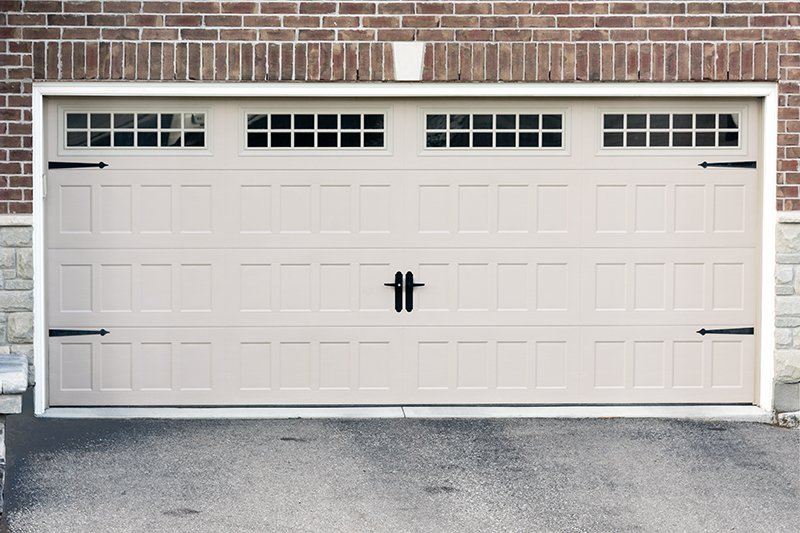 White, new garage doors, for two cars, in a new large cottage